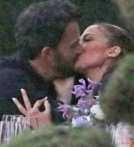 Loved-up video of Jennifer Lopez and Ben Affleck kissing at her sister's dinner party