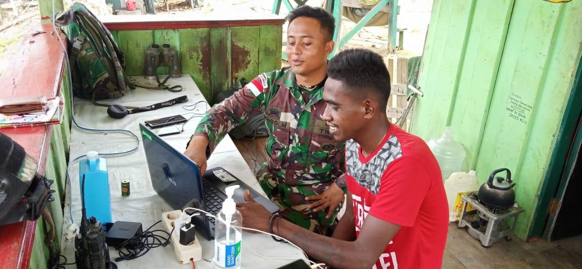 Satgas Yonif MR 413 Kostrad Ajarkan Pemuda Papua Operasikan Laptop