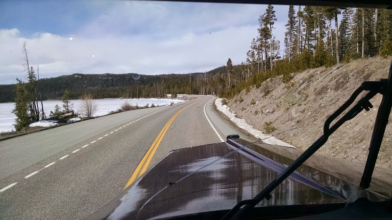 truckers scenery picture of open road  and snow-covered field