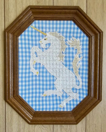 """Unicorn"", Holbein embroidery on gingham, framed under glass"