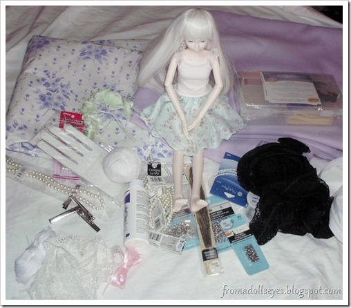 BJD Sitting Among Craft Supplies