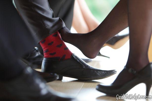 Couple playing footsie