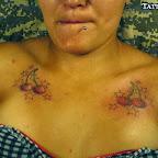 women chest cherry - tattoo designs