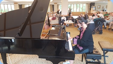 Hana Tani played the grand piano for us. Hana was joined for a couple of pieces by her mum, Yuko Tani for a duet.
