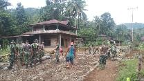 Semangat Warga Desa dan Satgas Selesaikan Pengerasan  Jalan Baru