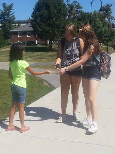 """This is my 9-year-old daughter, Gabriella, handing out gospel tracts at the University of New Hampshire. When people asked her what they were, she confidently, in her helium voice, said, """"They're about God!"""""""