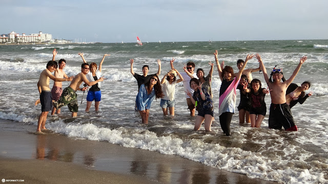 locals enjoying the Pacific ocean at Yuigahama Beach in Kamakura, Japan in Kamakura, Kanagawa, Japan