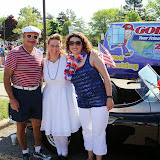 The Cinis pose with their historic car that led the GWBHS contingent in the parade.