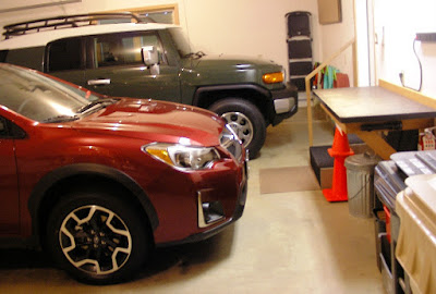 Raiju 2016 Subaru Crosstrek and 2011 Toyota Landcruiser in front garage workbench