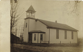 Original 1886 building with addition of belltower and entrance