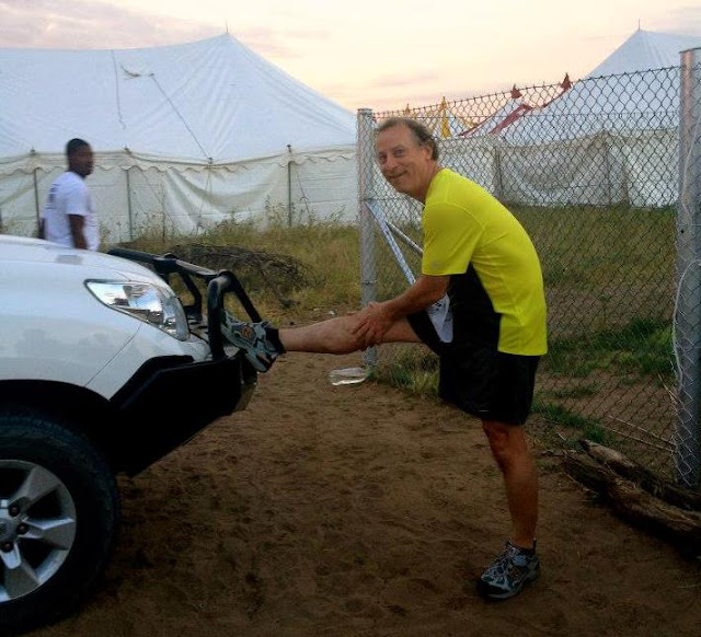 Country Director stretching before the race