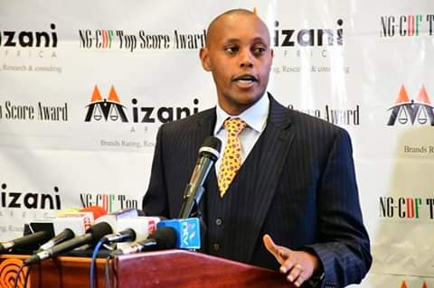 Kiharu Mp Ndindi Nyoro receiving an award from Mizani Africa. PHOTO | BMS