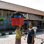 Women carrying heavy divegear to US Liberty wreck divesite (Tulamben, Bali)