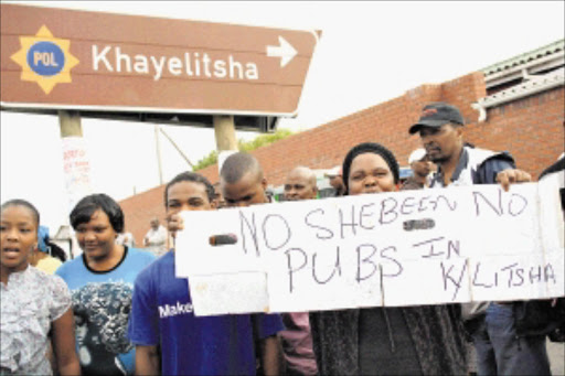 NO WAYS: Unlicenced Khayelitsha shebeen owners protested yesterday over plans to close down their operations. Pic: ELVIS KA NYELENZI. 10/03/2010. © Sowetan.