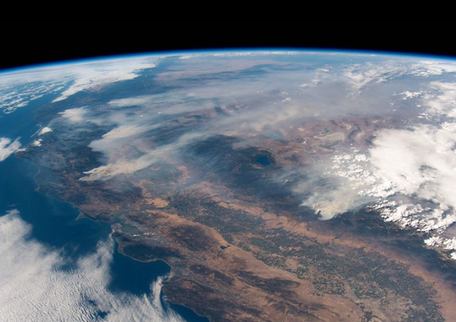 Image taken from the International Space Station shows the wildfires burning in California. In the upper left portion of the image is the Carr and Mendocino Complex fires and to the right is the Ferguson fire. Photo: Alexander Gerst / AFP / Getty Images