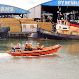 Poole ILB on her way to a broken down Thames launch. The crew have just gone under Poole Lifeting Bridge and are sorting out their equipment and kit. 21 August 2014 Photo: RNLI Poole/Anne-Marie Clark