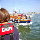 Trainee Suzie Jupp waiting onboard the 'casualty' vessel to receive the salvage pump from the Tyne class lifeboat Photo: RNLI Poole/Dave Riley