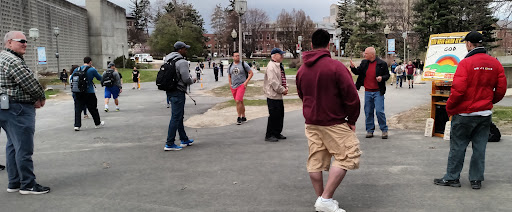 Students stop by and listen as Eric shares Jesus in the open air at UMass.