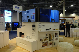 Photo: The biggest booth in the IoT for dogs.   And yes, it's more videoconferencing for pets, except now you can steer a laser to entertain the cat, and you can eject a pet treat while you ask the vital question of just who is a good girl?  You are!