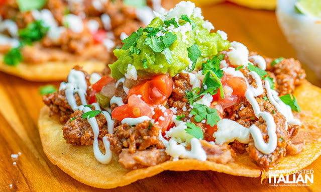 mexican chalupas topped with beans, taco beef and salsa