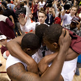 Jamar, Cherry, and Steward huddle up at the end of the game.