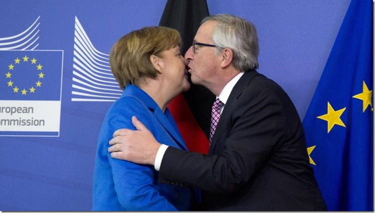 Juncker küßt Merkel
