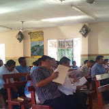 Pastors and church members studying their materials during the lessons