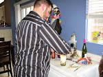 Jeff tries to open the wine, with no opener