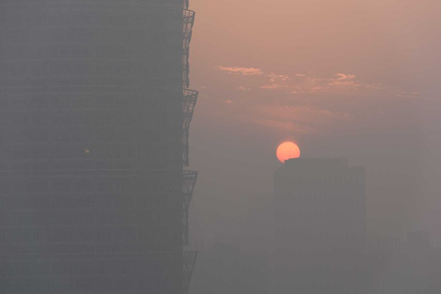 Sunset during record air pollution in China, 7 January 2017. Air quality was improving in 2016, until coal production ramped up in September. Photo: Reuters
