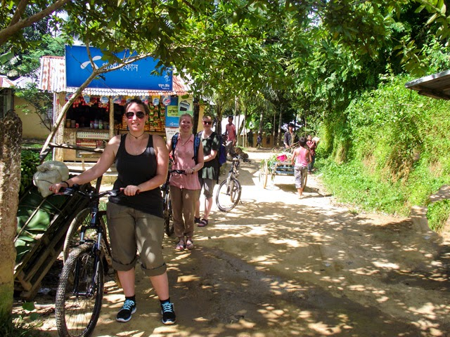 Cycling through a village road at Srimangal