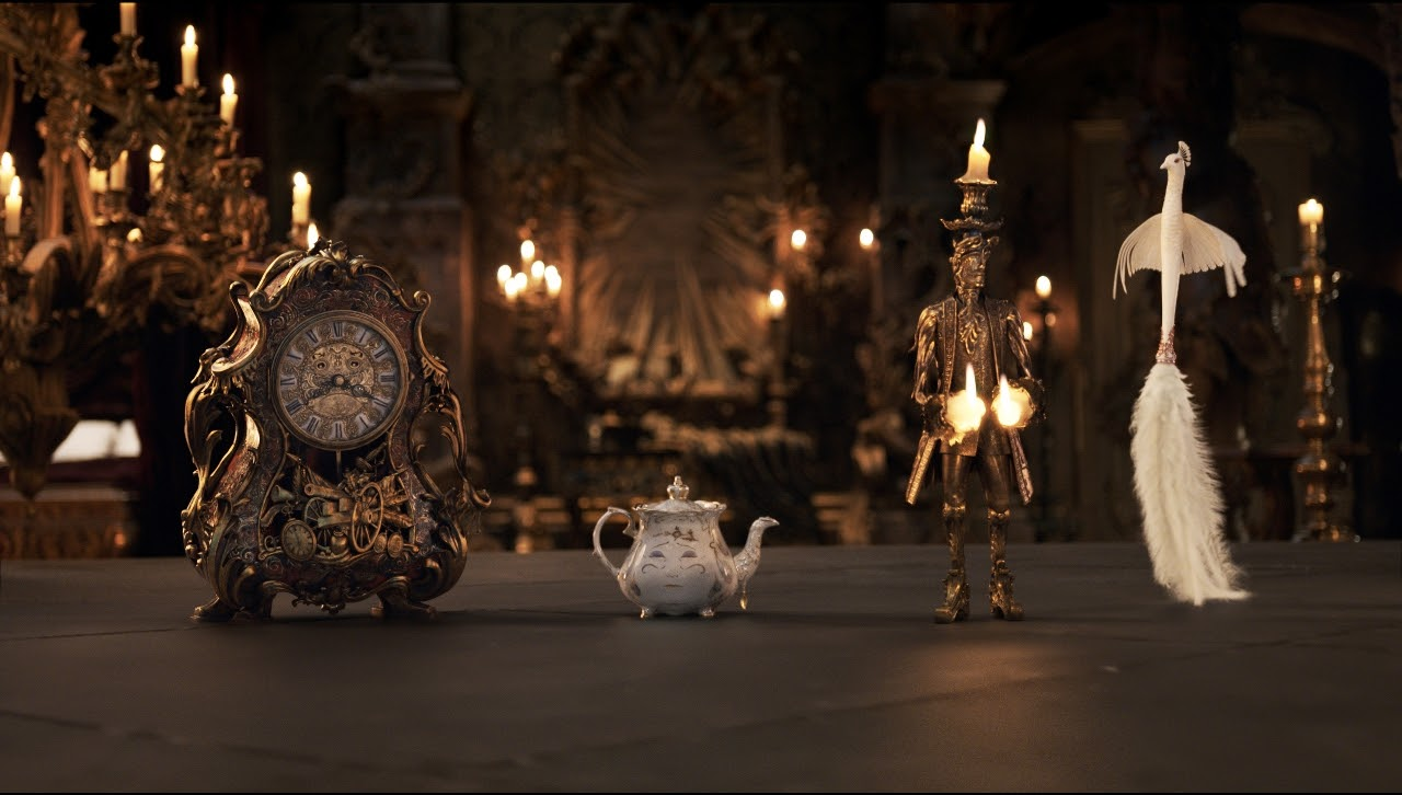 The mantel clock Cogsworth, the teapot Mrs. Potts, Lumiere the candelabra and the feather duster Plumette in BEAUTY AND THE BEAST. (Photo courtesy of Disney).
