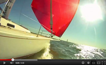 J/120 sailing under spinnaker in Galveston Bay, Texas