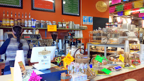 At Portland Mercado, inside the Cafe Revolucion Coffee Shop are Mexican drinks like various atoles, which are traditional hot corn masa based drinks with milk, cinnamon, and piloncillo (molasses) and other ingredients like strawberry or chocolate or pecan