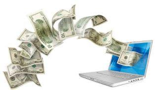 billetes dinero laptop