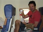Alex has his pile of tissues to get him through his sick flight