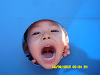 6.9.15 Outdoor Play Dylan in tunnel.jpg