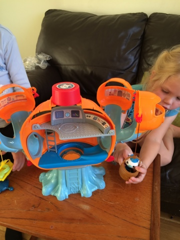 Blake Clement and Maegan Clement with the Fisher Price Octonauts Octopod Playset