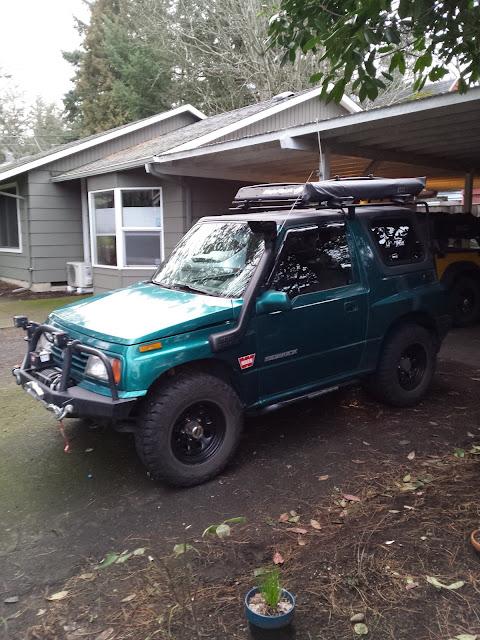 Suzuki Sidekick in driveway