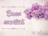 buon martedi immagine con frase aforismo fiori lilla vaso.jpg