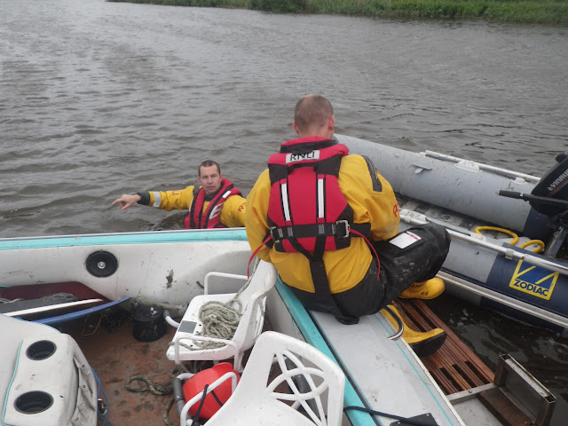 8 June 2012: ILB crew members Mark Ponchaud and Rob Inett recovering the grounded speedboat and tender. Photo: RNLI Poole/Dave Riley