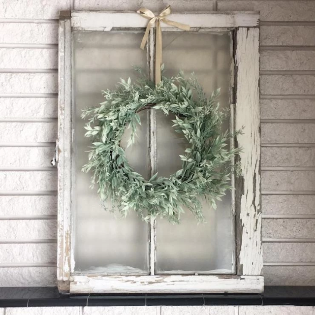 old window frame with wreath