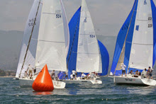 J/105s sailing around mark- setting spinnakers at Fiesta Cup Santa Barbara