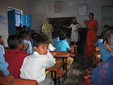 PVs assist a teacher in the primary school