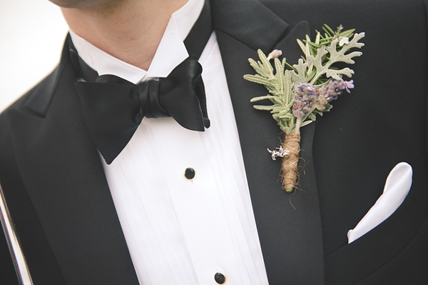 silver cat charm on groom wedding boutonniere
