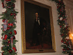 Even the portraits get a dose of Christmas decor at The White House.