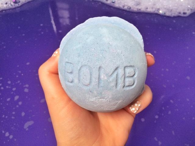 Blackberry bath bomb by Lush in girls hand