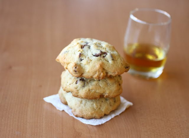 a stack of cookies with a glass of bourbon.