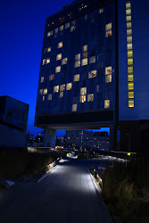 The Standard Hotel, infamous for its floor to ceiling glass windows, sits at Chelsea's High Line.
