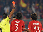 Mexican referee Marco Rodriguez (L) gives Chile's midfielder Marco Estrada (R) a red card as Chile's defender Waldo Ponce watches during the Group H first round 2010 World Cup football match Chile versus Spain on June 25, 2010 at Loftus Verfeld stadium in Tshwane/Pretoria. NO PUSH TO MOBILE / MOBILE USE SOLELY WITHIN EDITORIAL ARTICLE - AFP PHOTO / VINCENZO PINTO