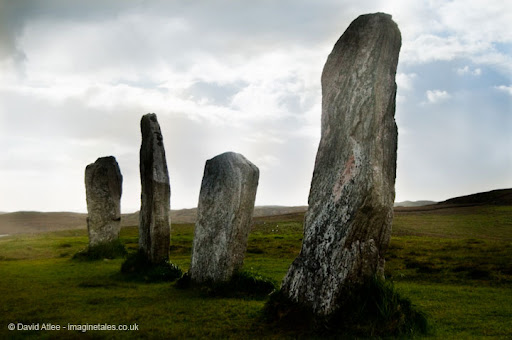 Four standing stones in a line